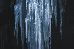 details of ice structures on a dark background