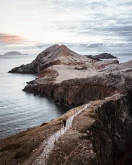 hiker along a path on the coast of Madeira