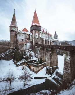 castle with a bridge as entrance in a snowy surrounding
