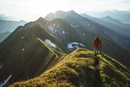person walking on a mountain ridge