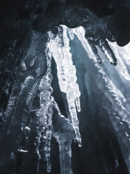 Huge icicle hanging down inside a gorge